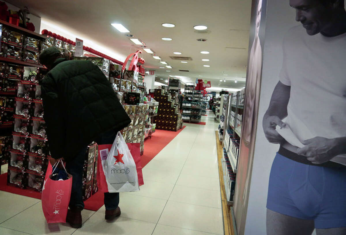 In this Dec. 13, 2013 photo, a shopper browses the aisles at Macy's flagship store in New York. Claims over racial profiling at department stores in New York have helped expose the practice in more than 40 states of retailers holding shoplifting suspects and assessing fines, even if a person hasn?'t yet technically stolen anything. At Macy?'s flagship store, suspects are held in cells, asked to sign an admission of guilt and pay hundreds in fines. (AP Photo/Bebeto Matthews)