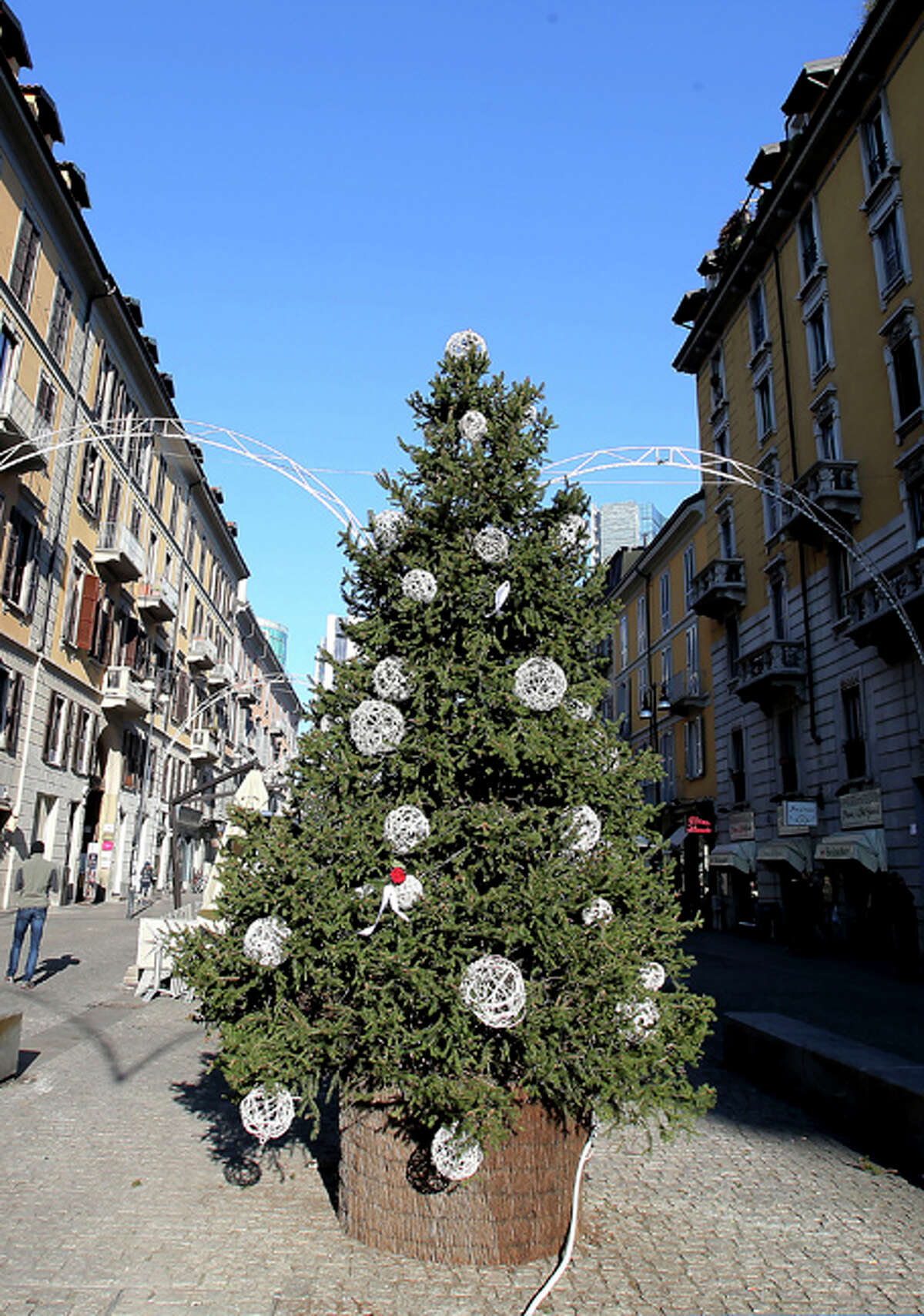 A Christmas tree the was previously adorned with red sex toys is displayed in a street, in Milan, Italy, Friday, Dec. 13, 2013. The provocatively adorned Christmas tree was just too naughty for Milan city officials, who ordered it denuded of its racy red sex toys. The city said in an order dated Thursday that the Christmas season,