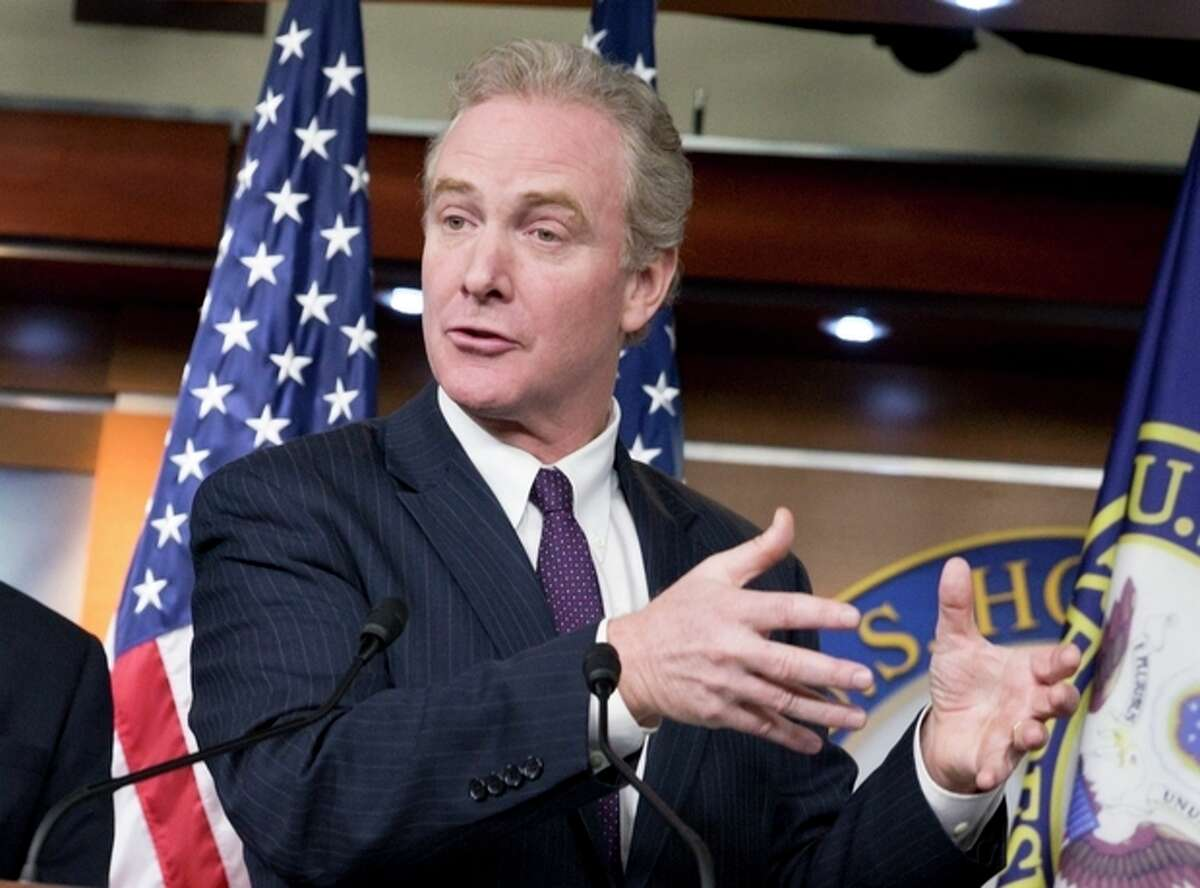 FILE - In this Dec. 5, 2013 file photo, Rep. Chris Van Hollen, D-Md., the ranking member of the House Budget Committee, center, takes at a news conference on Capitol Hill in Washington. Van Hollen, top Democrat on the House Budget Committee, said he signed off on the $6 billion increase for new federal employees hired beginning in January after Obama assured him he would propose no new retirement benefit cuts in next year?'s budget. (AP Photo/J. Scott Applewhite)
