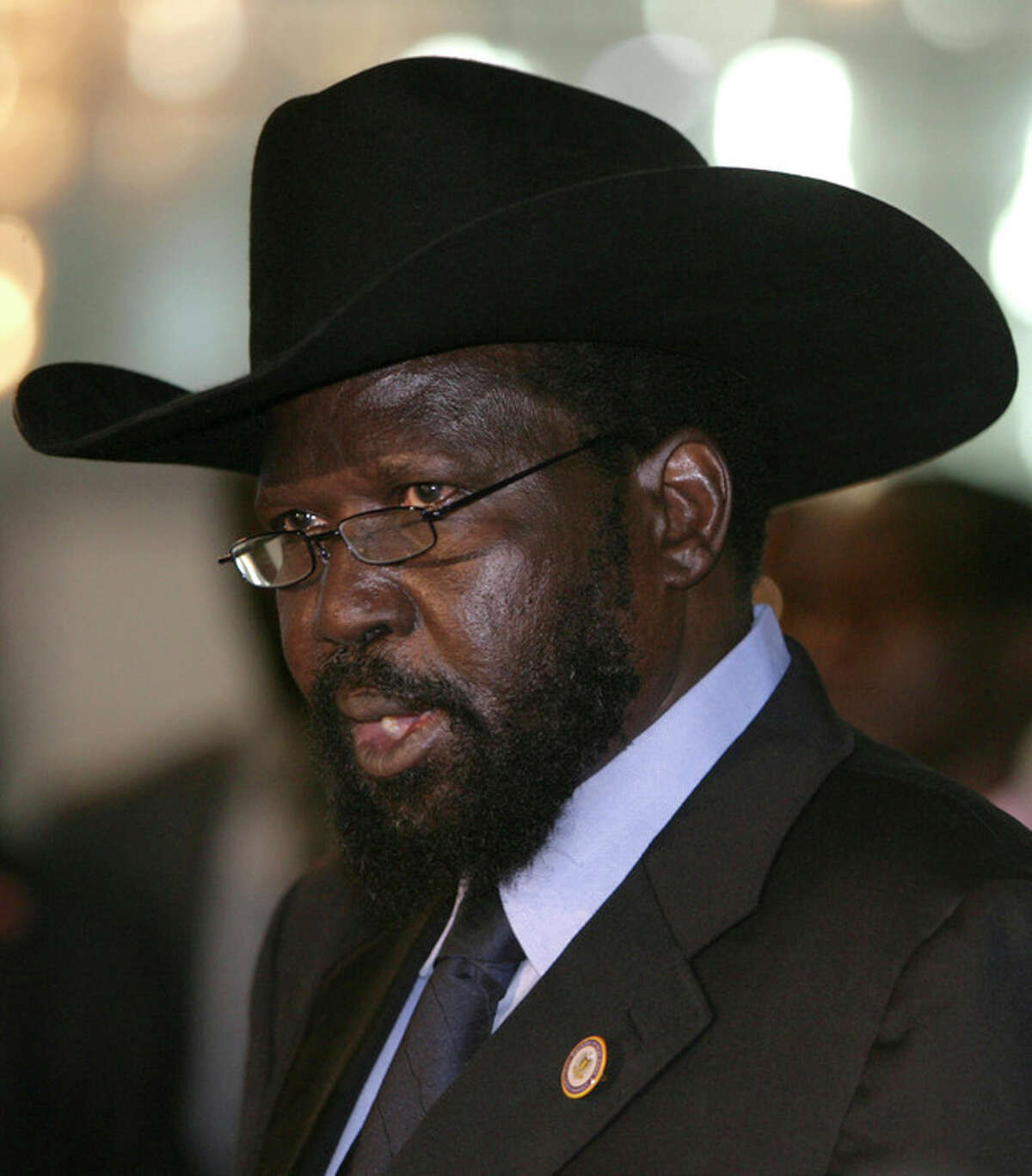 FILE - In this Oct. 9 2011 file, South Sudan's President Salva Kiir, speaks at a joint news conference at the airport in Khartoum, Sudan. Sporadic gunfire rang out early Monday, Dec. 16, 2013, in the South Sudan capital, Juba, in what a senior military official said were clashes between factions of the country's military. There has been political tension in the world's youngest nation since South Sudan President Kiir sacked Riek Machar as his deputy in July. The local Sudan Tribune newspaper reported on its website that clashes erupted late Sunday between members of the presidential guard in fighting that seemed to pit soldiers from Kiira's Dinka tribe against those from the Nuer tribe of Machar. (AP Photo/Abd Raouf, File)