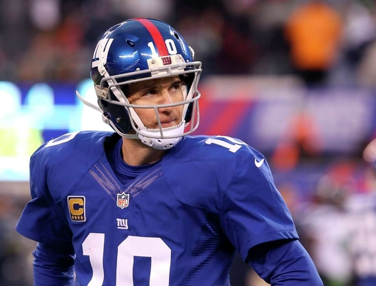 New York Giants quarterback Eli Manning looks on during the second half of an NFL football game against the Seattle Seahawks, Sunday, Dec. 15, 2013, in East Rutherford, N.J. The Seahawks won 23-0. (AP Photo/Peter Morgan)