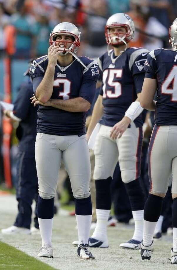 New England Patriots kicker Stephen Gostkowski (3) and quarterback Ryan Mallett (15) looks up during the last minutes of the second half of an NFL football game against the Miami Dolphins, Sunday, Dec. 15, 2013, in Miami Gardens, Fla. The Dolphins defeated the Patriots 24-20. (AP Photo/Lynne Sladky)