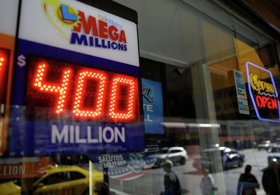 File-This Dec. 12, 2013 file photo shows a sign displaying the current Mega Millions jackpot at a Financial District liquor store in San Francisco. Lottery officials say the next Mega Millions prize could surpass last year's record $656 million jackpot. No one won the $425 million prize on Friday night. And officials Saturday Decx. 14, 2013, raised the amount to $550 million for Tuesday's drawing, the fourth-largest in U.S. history. (AP Photo/Eric Risberg, File) / AP