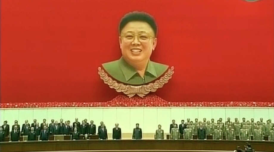 In this image taken from video, North Korean leader Kim Jong Un, center, attends an event to mark the second anniversary of the death of his father, former leader Kim Jong Il, in Pyongyang, North Korea Tuesday, Dec. 17, 2013. (AP Photo/KRT via AP Video) TV OUT, NORTH KOREA OUT / KRT via AP Video