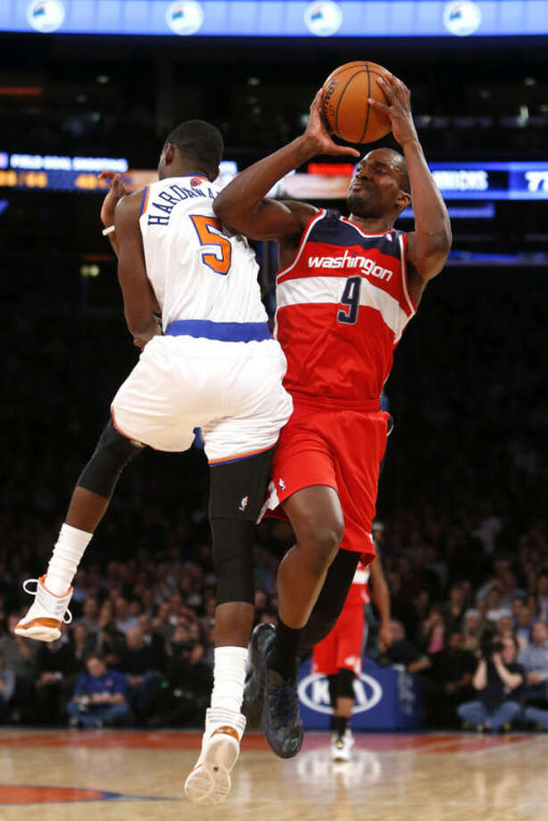Washington Wizards' Martell Webster (9) shoots against New York Knicks' Tim Hardaway Jr. (5) during the second half of an NBA basketball game Monday, Dec. 16, 2013, in New York. The Wizards won 102-101. (AP Photo/Jason DeCrow)