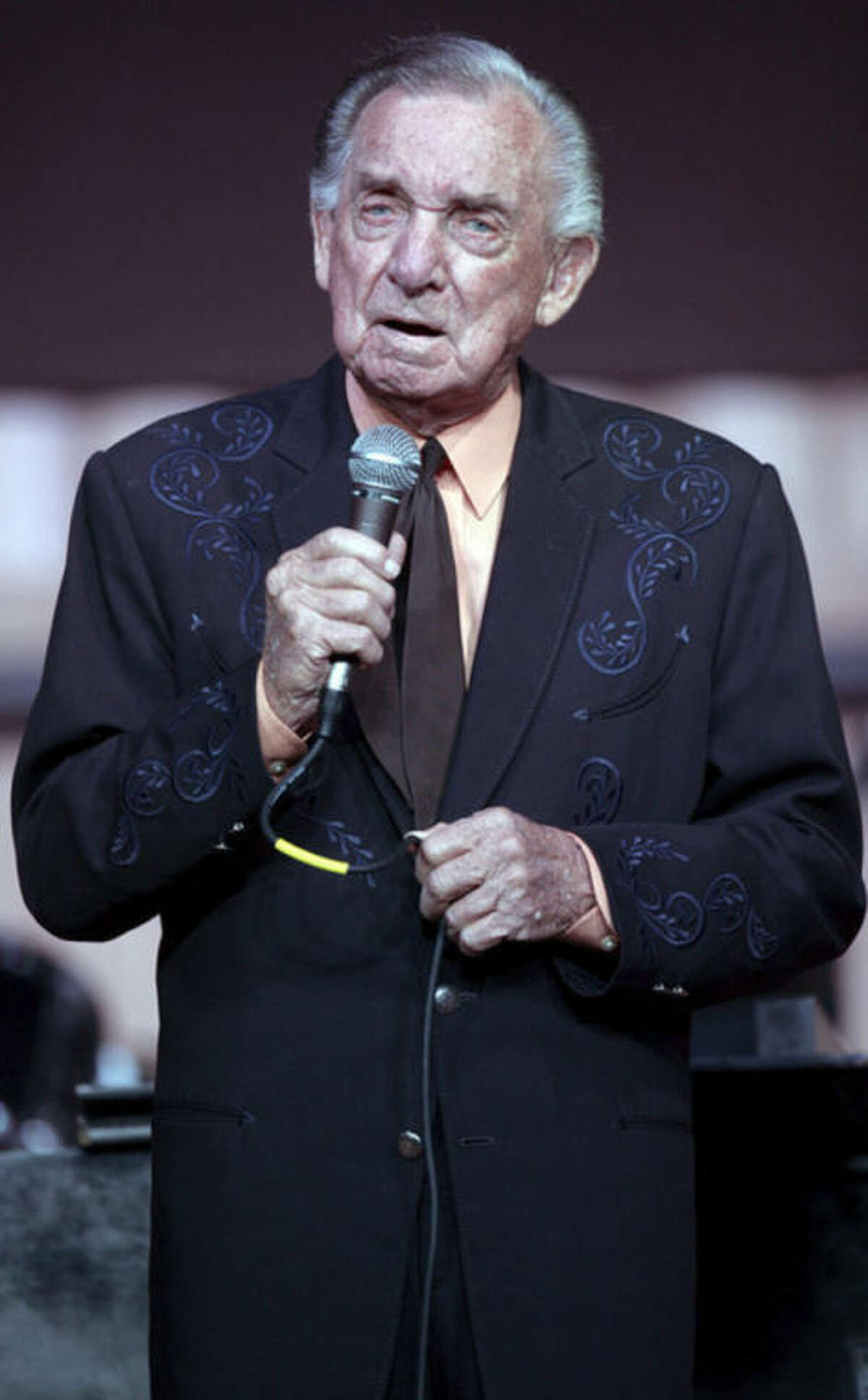 FILE - In a Jan. 7, 2011, file photo, Country Music Hall of Fame member and Grammy award winner Ray Price celebrates his 86th birthday by performing in Bullard Texas. Price, one of country music's most popular and influential singers and bandleaders who had more than 100 hits and was one of the last living connections to Hank Williams, died Monday, Dec. 16, 2013. He was 87. (AP Photo/Dr. Scott M. Lieberman, File)