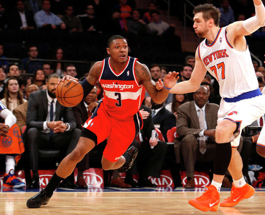 Washington Wizards' Bradley Beal (3) drives against New York Knicks' Andrea Bargnani (77), of Italy, during the second half of an NBA basketball game Monday, Dec. 16, 2013, in New York. The Wizards won 102-101. (AP Photo/Jason DeCrow) / FR103966 AP