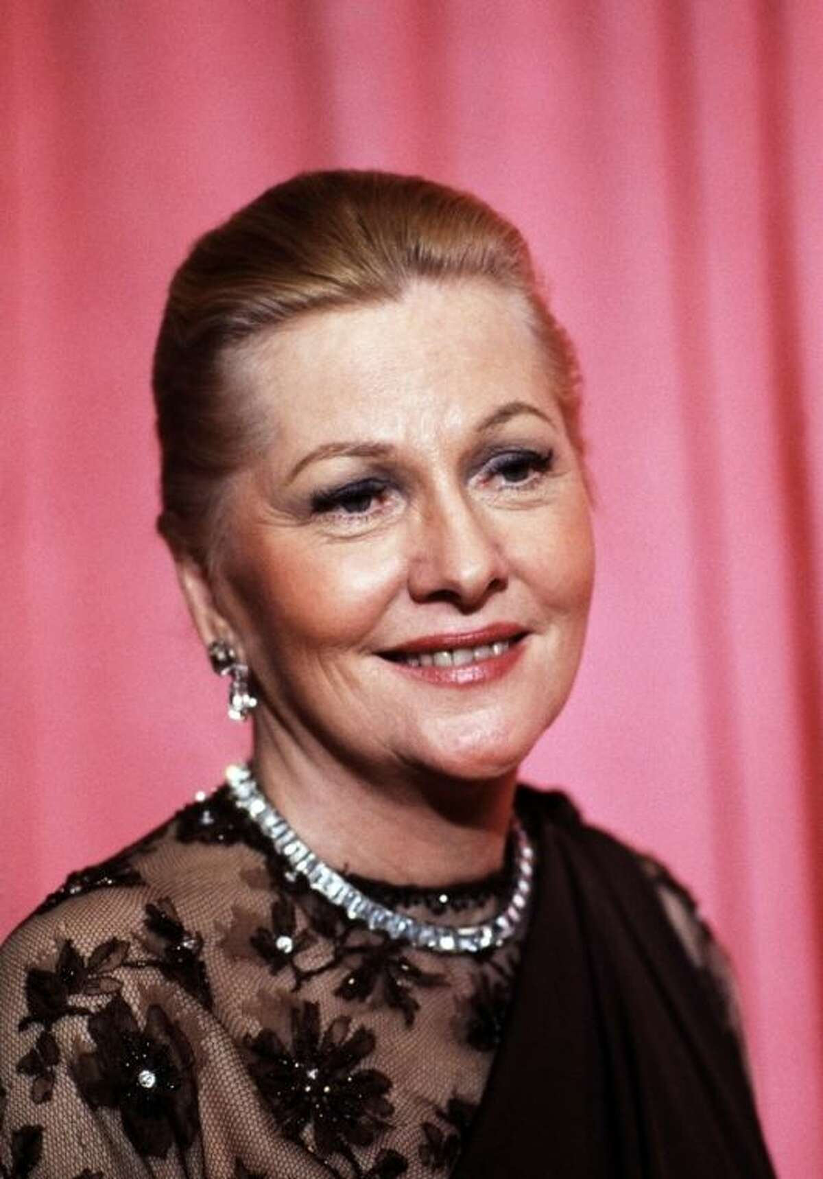 File- This April 3, 1978 file photo shows actress Joan Fontaine at the 50th Annual Academy Awards in Los Angeles. The Oscar-winning actres has died at the age of 96. Longtime friend Noel Beutel says she died in her sleep in her Carmel home Sunday, Dec. 15, 2013. (AP Photo/File)