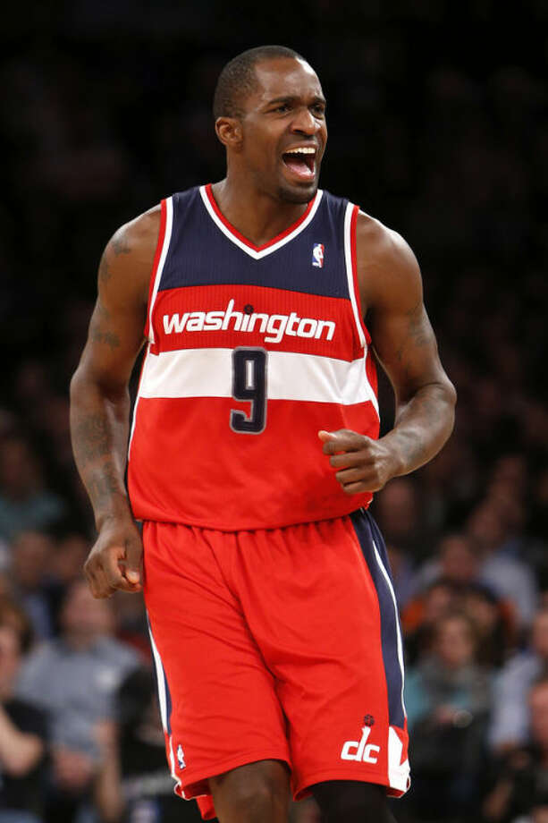 Washington Wizards' Martell Webster (9) reacts after scoring against the New York Knicks during the second half of an NBA basketball game Monday, Dec. 16, 2013, in New York. The Wizards won 102-101. (AP Photo/Jason DeCrow)