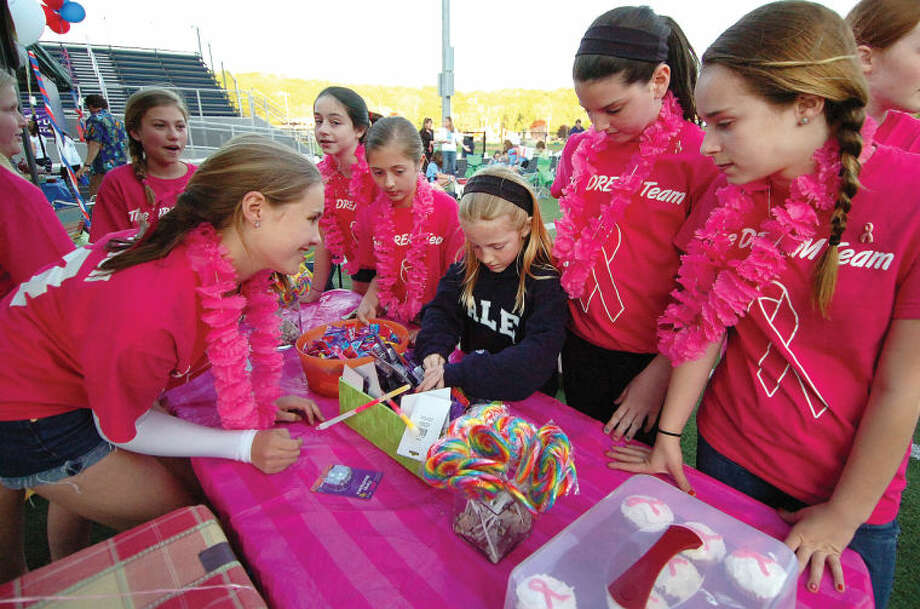 "Hour Photo/ Alex von Kleydorff. 7 yr old Molly Snow picks out her prizes from the bean bag toss with help from members of ""The Dream Team' who raised more than Ten Thousand dollars for Wiltons Relay for Life and The American Cancer Society."
