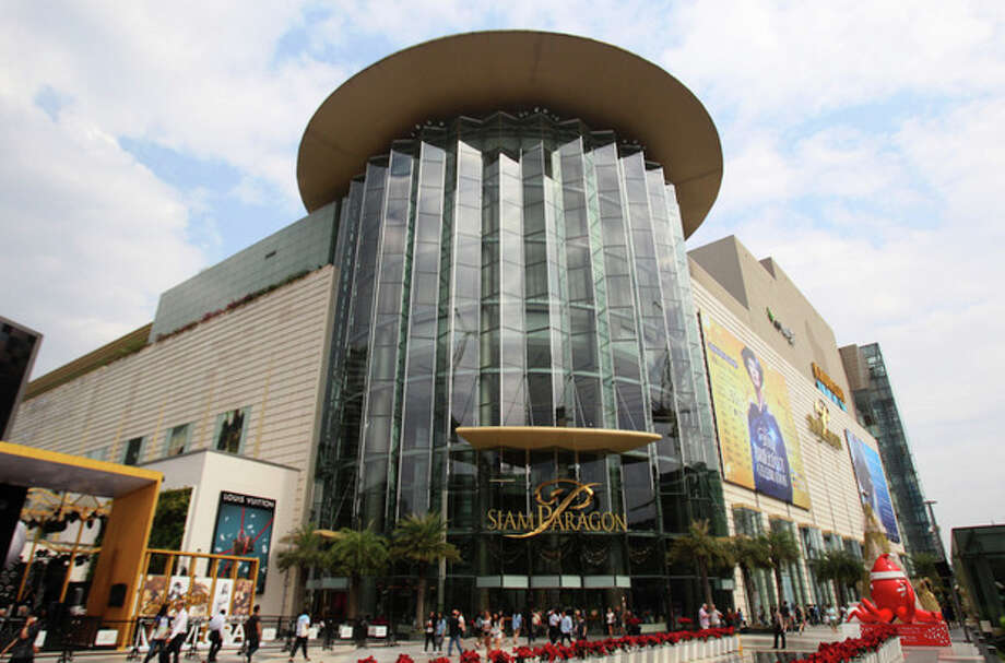 In this photo taken on Monday, Dec. 16, 2013, shoppers walk in front of Siam Paragon, a shopping mall in Bangkok, Thailand. Siam Paragon has claimed this year's crown as the world's most photographed location on Instagram. It edged out No. 2 Times Square and No. 3 Disneyland in California on the list that also includes New York's Central Park and Dodger Stadium in Los Angeles. (AP Photo/Sakchai Lalit) / AP