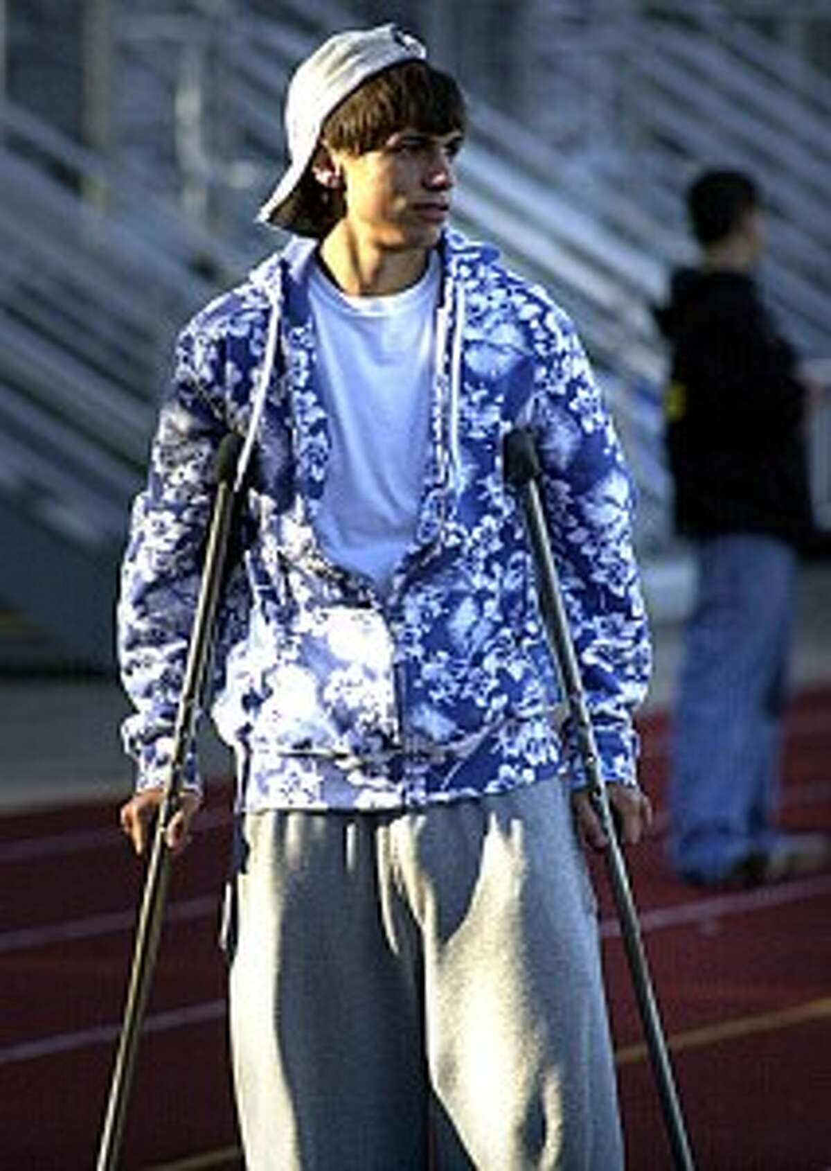 Felipe spotted on crutches