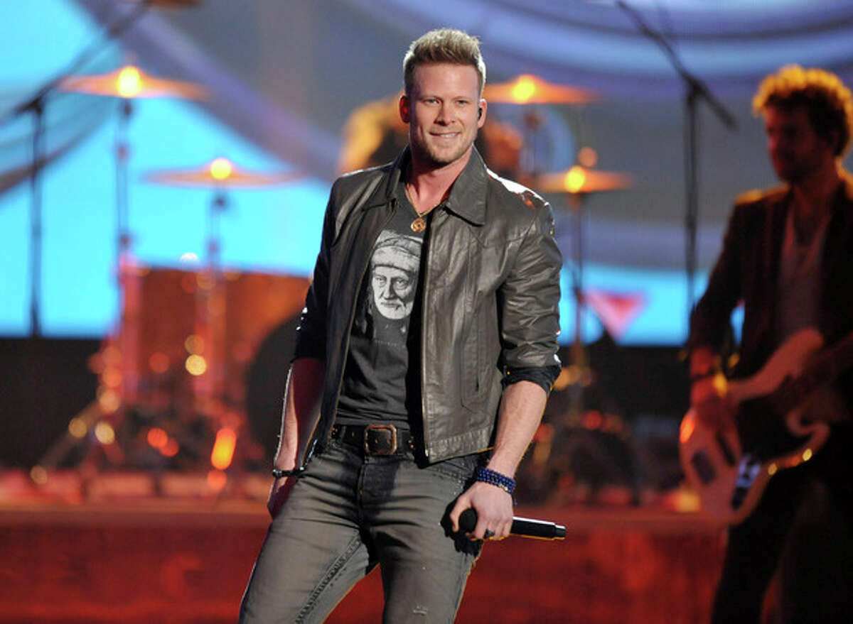 FILE - This Nov. 24, 2013 file photo shows Brian Kelley of the musical group Florida Georgia Line on stage at the American Music Awards in Los Angeles. Kelley of the country duo Florida Georgia Line capped off a year full of awards and breaking records by marrying his girlfriend Brittney Marie Cole at an intimate ceremony in Nashville. The wedding on Monday, Dec. 16, was first reported by People magazine. The band?'s publicist said the ceremony included just 40 guests at sunset, followed by a reception at Kelley?'s 32-acre property. (Photo by John Shearer/Invision/AP, File)