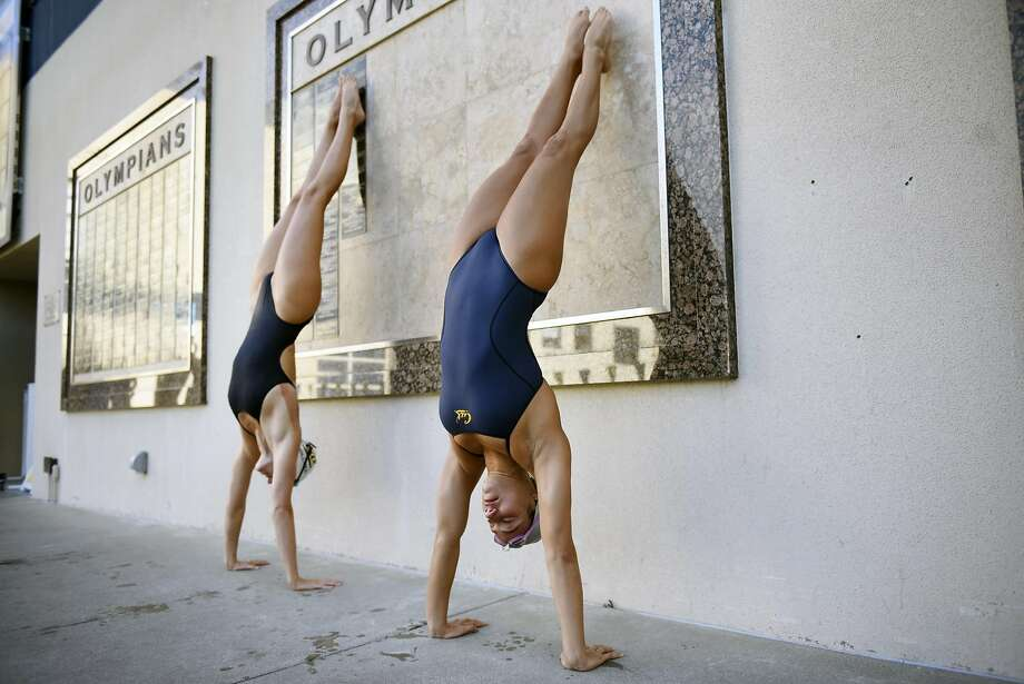 Cal swimmer Farida Osman, right, who hopes to represent her native Egypt in the 2016 Olympic Games in Rio De Janeiro, does a handstand with post graduate swimmer Dana Vollmer as they practices with their swim team at the Spieker Aquatics Complex on the UC Berkeley campus in Berkeley, CA Thursday, June 16, 2016. Photo: Michael Short, Special To The Chronicle