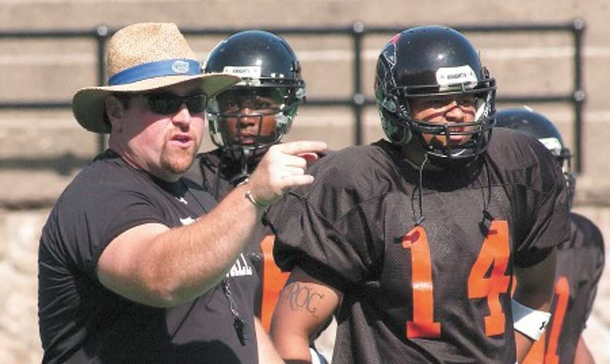 Photo by John Nash - Kevin Jones, left, head coach of the Stamford football works with his team during a recent practice.