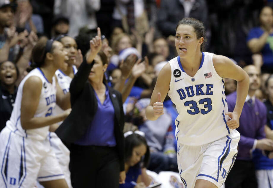 Duke's Haley Peters (33) reacts following a basket against Connecticut during the second half of an NCAA college basketball game in Durham, N.C., Tuesday, Dec. 17, 2013. Connecticut won 83-61.(AP Photo/Gerry Broome)