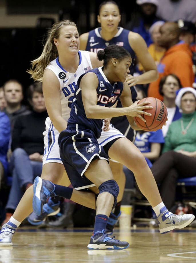 Connecticut's Moriah Jefferson is guarded by Duke's Tricia Liston, rear, during the first half of an NCAA college basketball game in Durham, N.C., Tuesday, Dec. 17, 2013. (AP Photo/Gerry Broome)