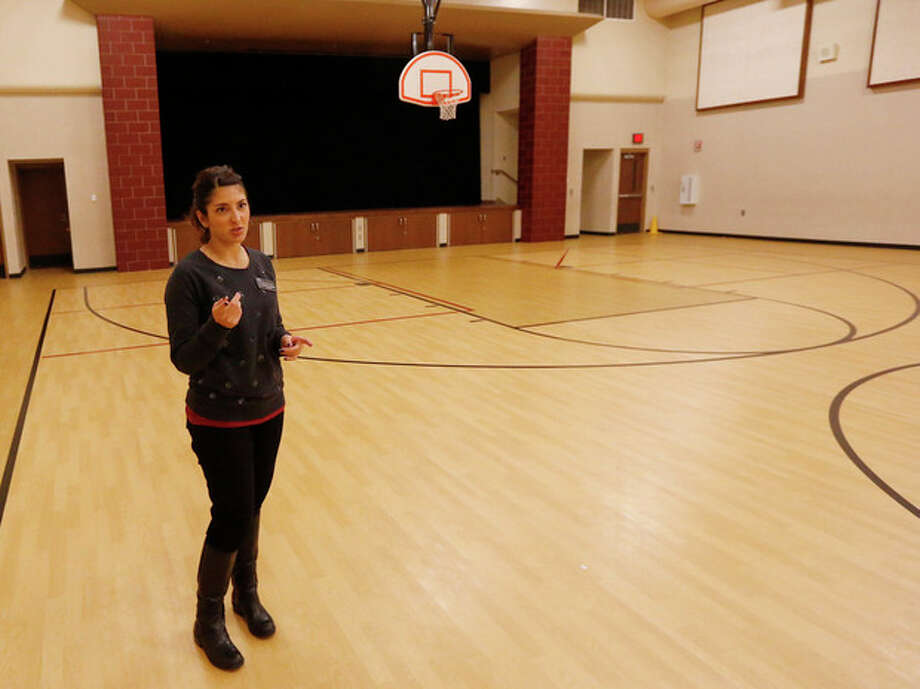 Mekele DeNegri, a teacher at Truman Primary School, stands in the gymnasium at the school in Norman, Okla., Tuesday, Nov. 12, 2013. The gymnasium was built to serve as a safe room for the students. (AP Photo/Sue Ogrocki) / AP