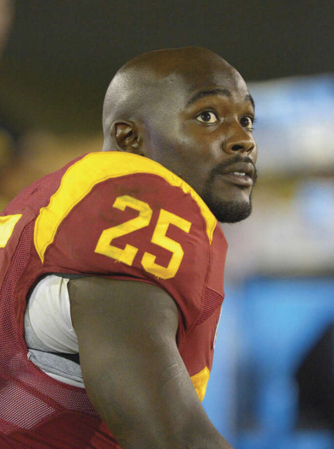 Southern California running back Silas Redd looks on during the second half of their NCAA college football game against Arizona, Thursday, Oct. 10, 2013, in Los Angeles. USC won 38-31. (AP Photo/Mark J. Terrill)