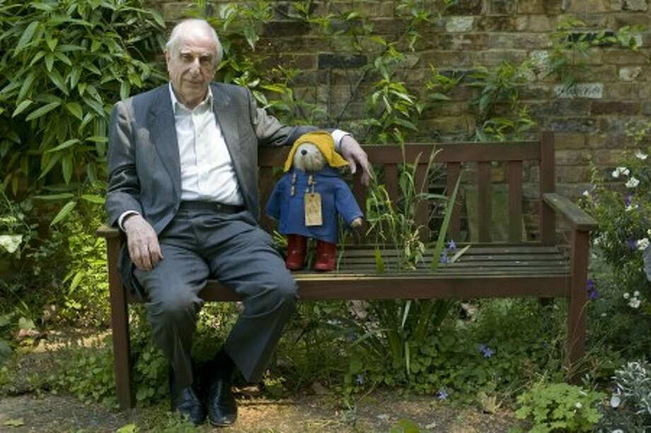 Author Michael Bond sits with a Paddington Bear toy in London, June 5. (AP Photo/Sang Tan)