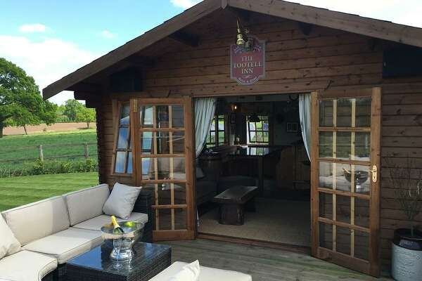 "A backyard pub competing for the UK's Cuprinol's Shed of the Year competition. ""He Sheds,"" or backyard pubs are becoming a growing trend."