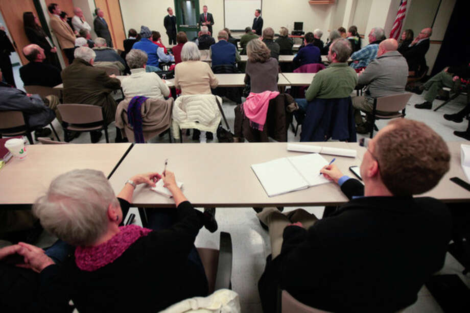 Hour photo / Chris Palermo. Residents pack the Norwalk Police Department Community Room as State Sen. Bob Duff addresses the residents at the public meeting hosted by Duff and Mayor Harry W. Rilling to discuss the future of Manresa Island Wednesday night. / © 2013 Hour Newspapers All Rights Reserved.