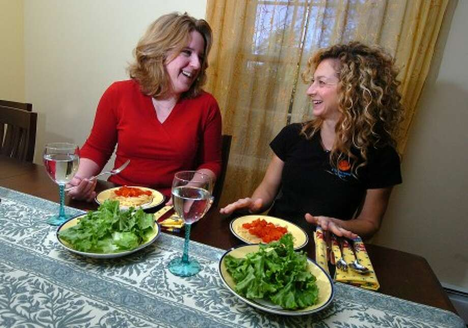 Photo/Alex von Kleydorff. Nnutritionist and Chef Lisa Corrado serves a healthy lunch of pasta and greens for her and Event Marketing manager Corrinn Gutierrez.