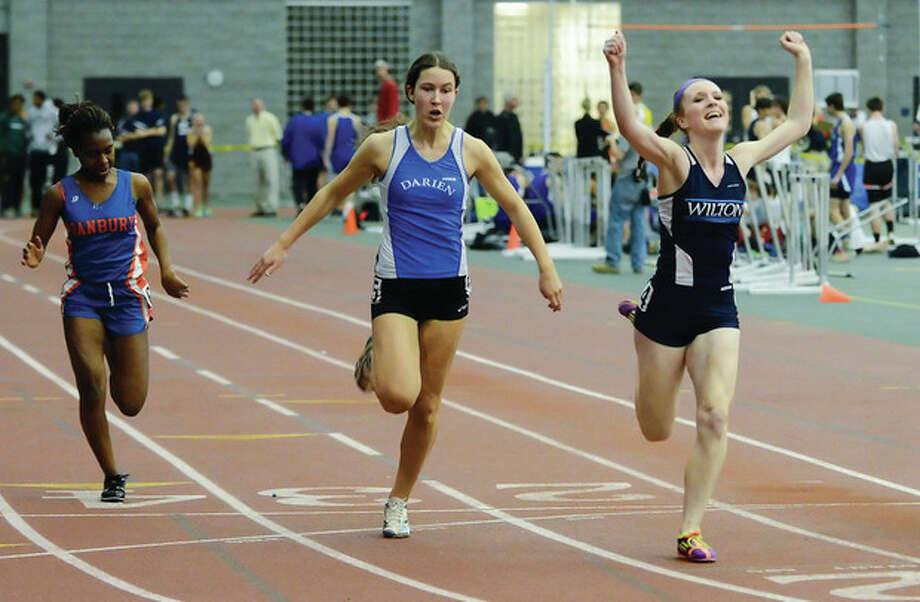 Photo by Fred GastonWilton's Shannon Quinlan, right, won the 55 and 300 dashes in the FCIAC last season and the Warriors are hoping for more success out of her during the upcoming indoor track season.