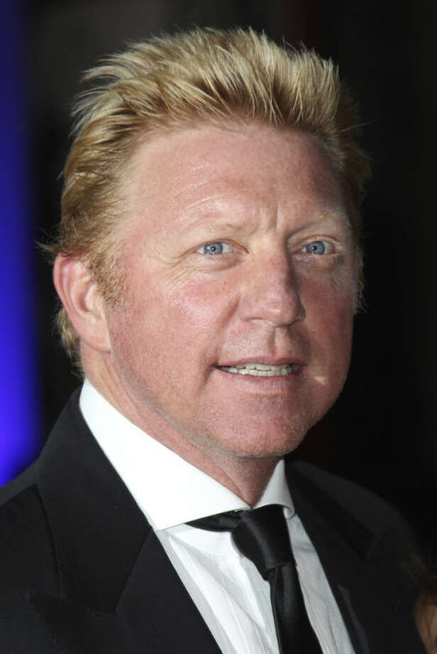 FILE - In this Wednesday, July 25, 2012 file photo, Boris Becker arrives for the 'Sports For Peace' Fundraising Ball at The V&A museum in central London. Novak Djokovic is turning to Boris Becker for help in 2014. The second-ranked Serb said Wednesday Dec. 18, 2013 that six-time Grand Slam champion Boris Becker will join his staff for next season as head coach. (AP Photo/Joel Ryan, File)