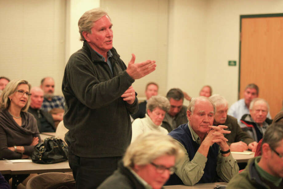 Hour photo / Chris Palermo. Charlie Taney, chairman of the Manresa Neighborhood Association ask a question at the public meeting hosted by Duff and Mayor Harry W. Rilling to discuss the future of Manresa Island Wednesday night. / © 2013 Hour Newspapers All Rights Reserved.