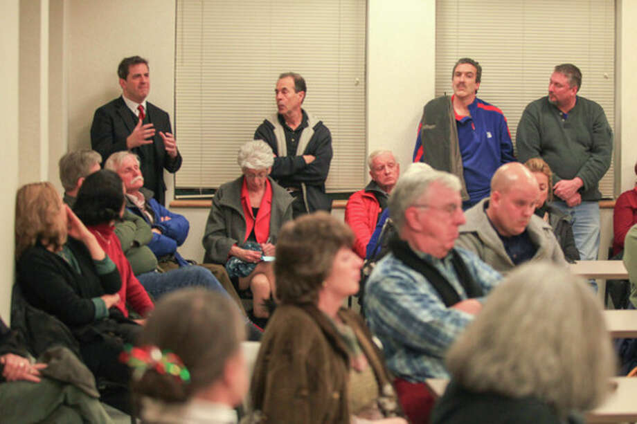 Hour photo / Chris Palermo. State Rep. Chris Perone asks a question during the public meeting hosted by Duff and Mayor Harry W. Rilling to discuss the future of Manresa Island Wednesday night in the Norwalk Police Department Community Room. / © 2013 Hour Newspapers All Rights Reserved.