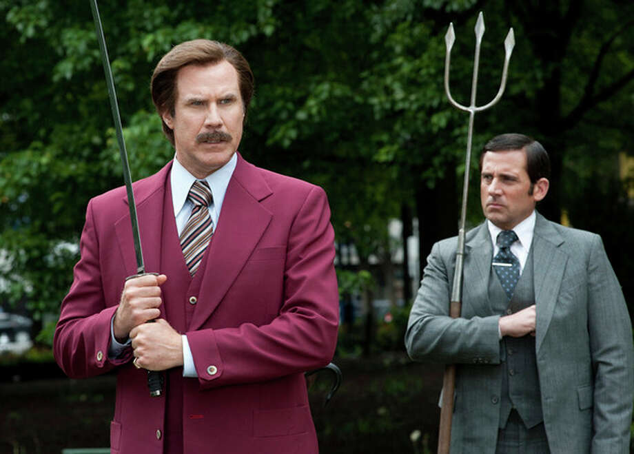 "This image released by Paramount Pictures shows Will Ferrell as Ron Burgundy, left, and Steve Carell as Brick Tamland in a scene from ""Anchorman 2: The Legend Continues."" (AP Photo/Paramount Pictures, Gemma LaMana) / Paramount Pictures"