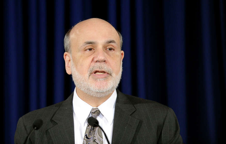 Federal Reserve Chairman Ben Bernanke speaks during a news conference at the Federal Reserve in Washington, Wednesday, Dec. 18, 2013. The Fed will begin to reduce bond purchases by $10 billion in January because of a stronger U.S. job market.(AP Photo/Susan Walsh) / AP