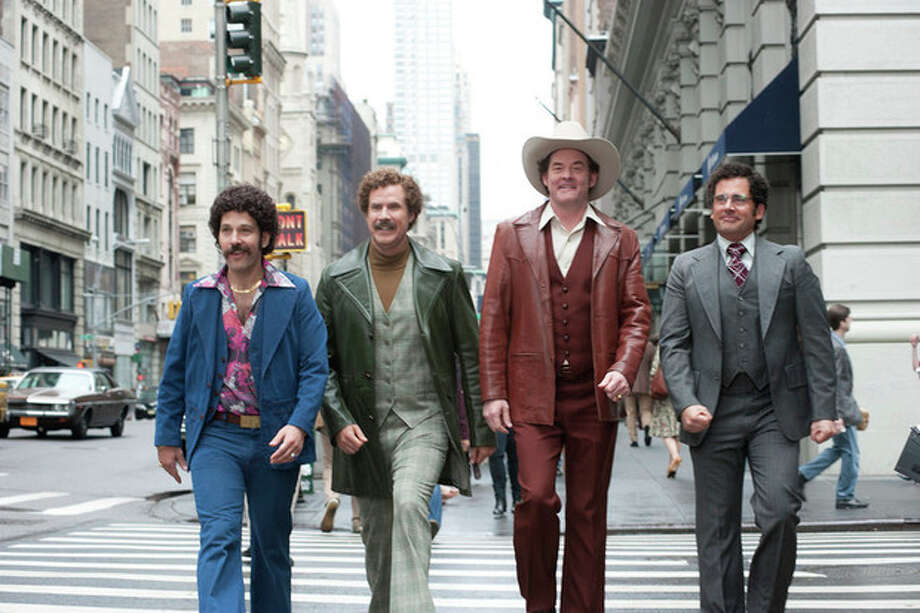 "This image released by Paramount Pictures shows, from left, Paul Rudd is Brian Fantana, Will Ferrell is Ron Burgundy, David Koechner is Champ Kind and Steve Carell is Brick Tamland in a scene from ""Anchorman 2: The Legend Continues."" (AP Photo/Paramount Pictures, Gemma LaMana) / Paramount Pictures"