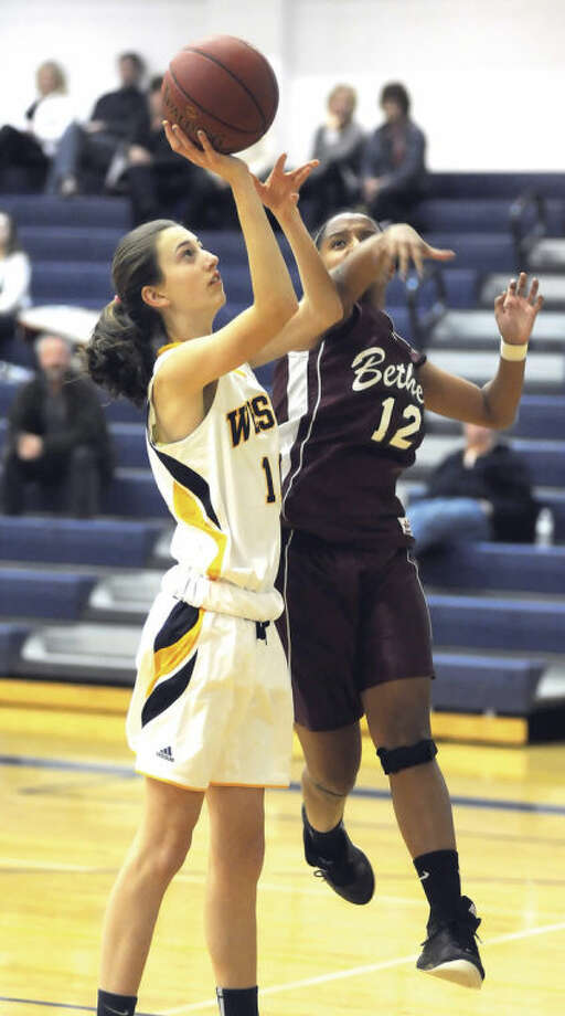 Hour photo/John NashWeston's Bridget Mahony, left, avoids getting her shot blocked by Bethel's Danika Wagener during Thursday's game in Weston.