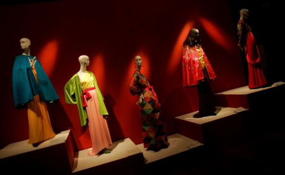 Various ensembles designed by Yves Saint Laurent are shown at his exhibit at the de Young Museum in San Francisco. (AP Photo)