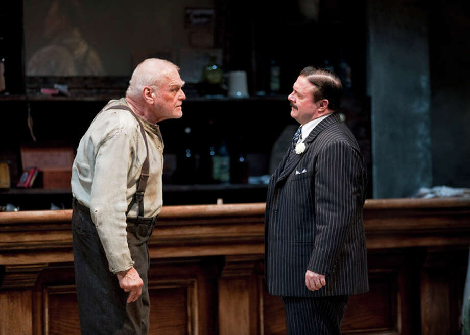 "In this April 20, 2012, production photo provided by the Goodman Theatre in Chicago, actors Brian Dennehy, left, portraying one-time syndicalist-anarchist Larry Slade and Nathan Lane as Theodore ""Hickey"" Hickman perform in a scene in Eugene O'Neill's ""The Iceman Cometh."" The Brooklyn Academy of Music said Tuesday the pair will present the five-hour work for a six-week run in the BAM Harvey Theater from Feb. 5 through March 15. (AP Photo/Courtesy of The Goodman Theatre, Liz Lauren) / Goodman Theatre"