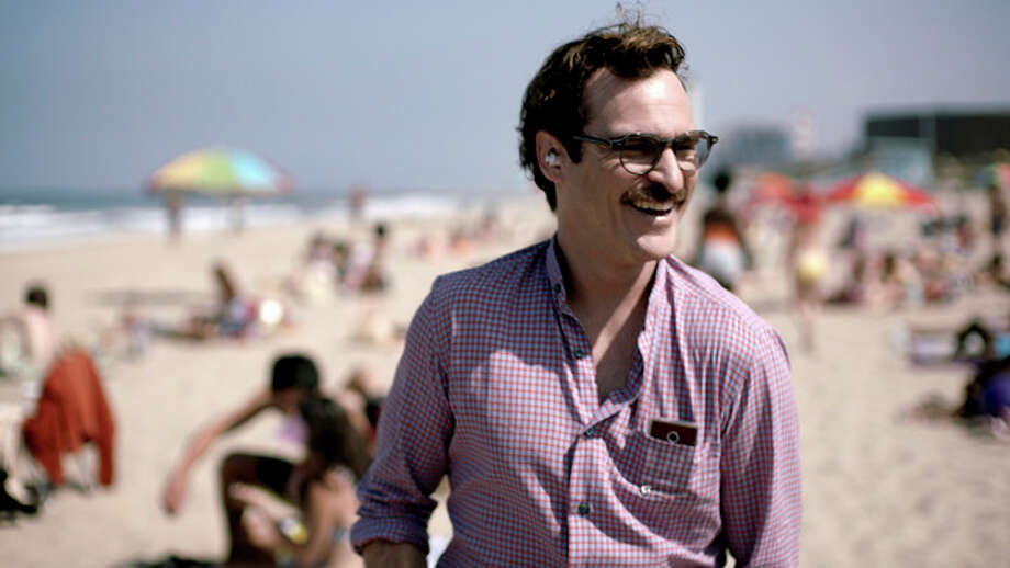 "FILE - This file image provided by Warner Bros. Pictures shows Joaquin Phoenix in a scene from ""Her."" In ""Her,"" Spike Jonze's futuristic exploration of a man's relationship with his computer, the filmmaker surveys human disjunction. (AP Photo/Warner Bros. Pictures, File) / Warner Bros. Pictures"