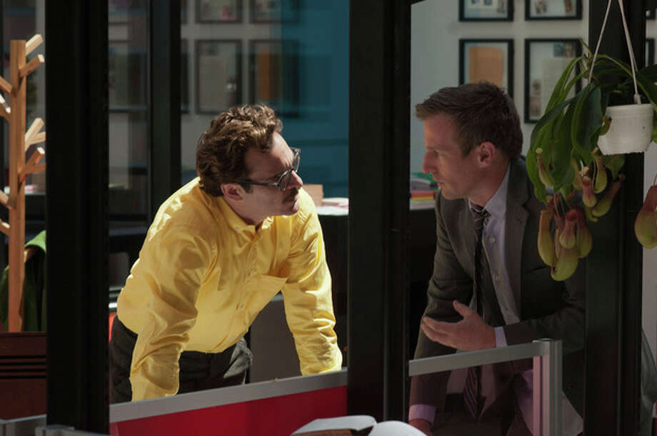 "This image released by Warner Bros. Pictures shows Joaquin Phoenix, left, and director Spike Jonze on the set of ""Her."" The film has been selected as the best film of the year by the National Board of Review and Phoenix was nominated for a Golden Globe for best actor in a motion picture musical or comedy. (AP Photo/Warner Bros. Pictures, Merrick Morton) / Warner Bros. Pictures"