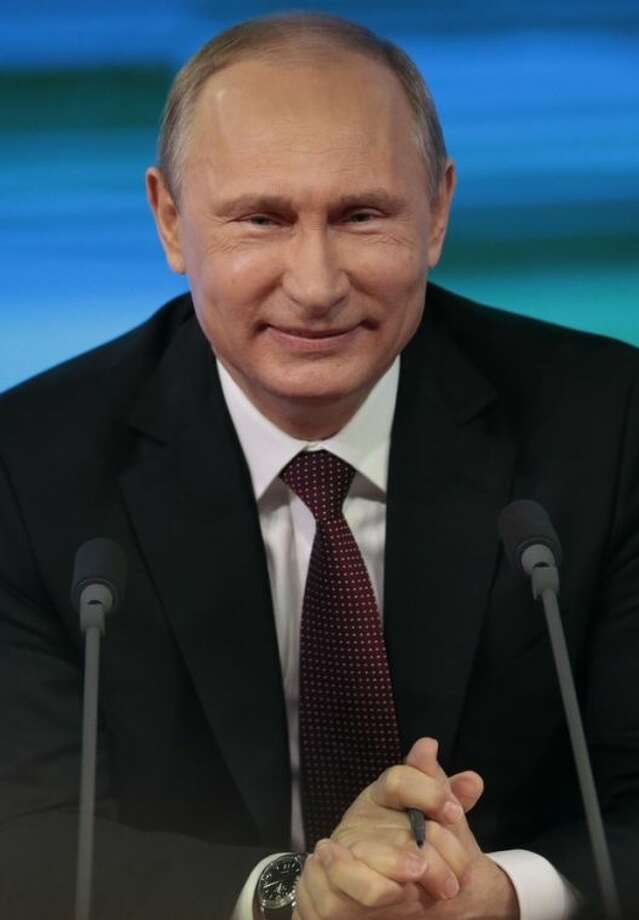 Russian President Vladimir Putin listens to a question during his annual news conference in Moscow, Russia, Thursday, Dec. 19, 2013. Putin says that Russia hasn't deployed missiles to its westernmost Baltic exclave, but continues to see it as a possible way of countering the U.S.-led missile defense in Europe. (AP Photo/Ivan Sekretarev)