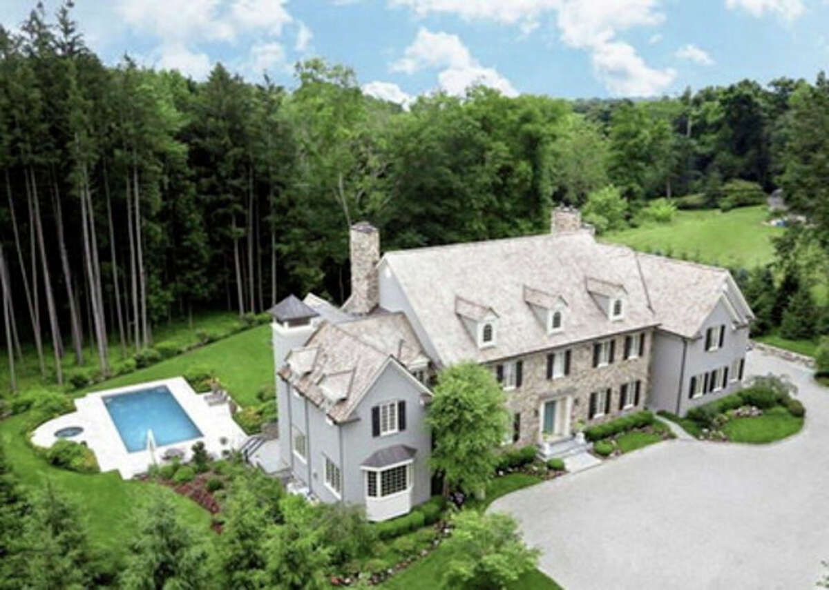 Contributed photo An aerial view of 4 Pan Handle Lane in Westport, featuring swimming pool and frontage on the Saugatuck River.