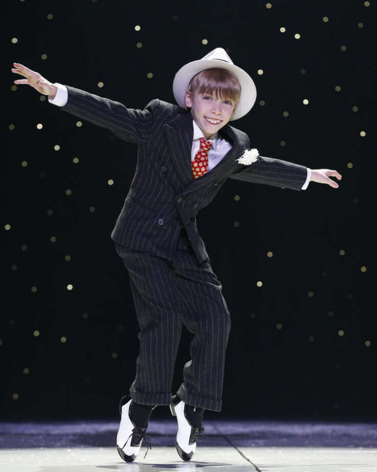 "This undated image released by Keith Sherman & Associates shows Luke Spring during a performance of ""A Christmas Story: The Musical."" Spring has tapped his way onto ""The Ellen DeGeneres Show,"" the Tony Award telecast from Radio City Music Hall, and now ""A Christmas Story: The Musical,"" at Madison Square Garden until Dec. 29. (AP Photo/Keith Sherman & Associates, Carol Rosegg)"
