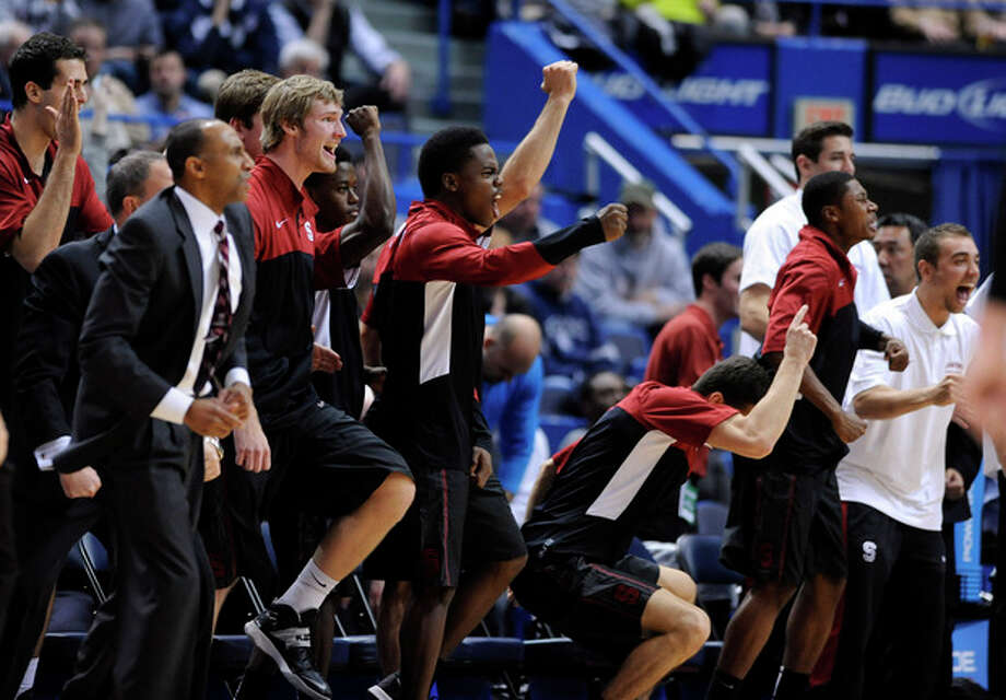 Stanford players celebrate late in their team's 53-51 victory over Connecticut in an NCAA college basketball game in Hartford, Conn., Wednesday, Dec. 18, 2013. (AP Photo/Fred Beckham) / FR153656 AP