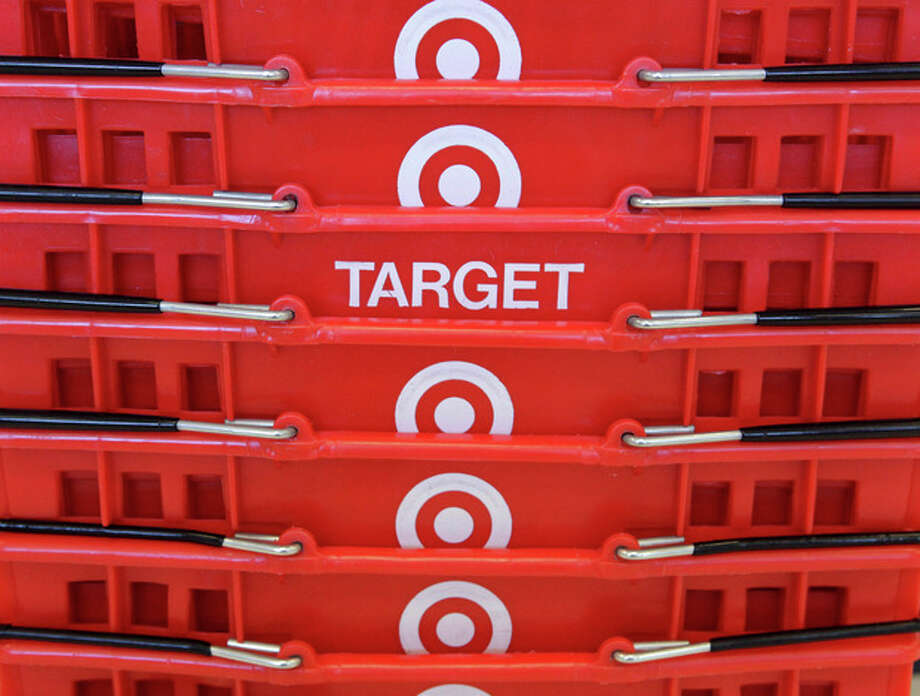 FILE - In this May 20, 2009 file photo, shopping baskets are stacked at a Chicago area Target store. Target says that about 40 million credit and debit card accounts customers may have been affected by a data breach that occurred at its U.S. stores between Nov. 27, 2013, and Dec. 15, 2013. (AP Photo/Charles Rex Arbogast, File) / AP