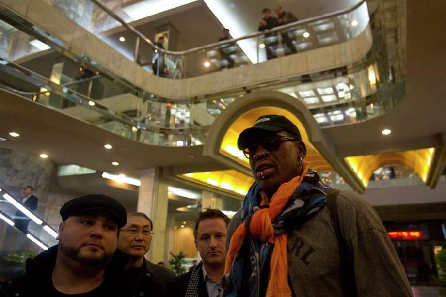 North Koreans look down from a balcony as former NBA basketball star Dennis Rodman enters the Koryo Hotel in Pyongyang, North Korea Thursday, Dec. 19, 2013. Rodman arrived to the North Korean capital to help train the national team and renew his friendship with the North's young leader, Kim Jong Un. (AP Photo/David Guttenfelder) / AP