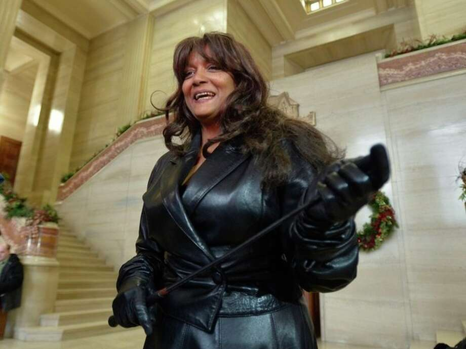 Terri-Jean Bedford talks to reporters at the Supreme Court of Canada in Ottawa Friday morning, Dec. 20, 2013 after learning Canada's highest court struck down the country's prostitution laws in their entirety in a unanimous 9-0 ruling. The retired dominatrix is one of the three principles in the Supreme Court case. The ruling is a victory for sex workers seeking safer working conditions because it found that the laws violated the guarantee to life, liberty and security of the person. But the decision also gives Parliament a one-year reprieve to respond with new legislation. (AP Photo/The Canadian Press, Adrian Wyld) / The Canadian Press