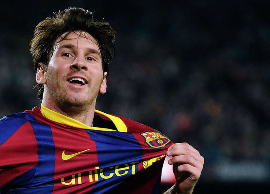FILE - In this April 9, 2011 file photo, FC Barcelona's Lionel Messi from Argentina, celebrates after scoring during his Spanish La Liga soccer match against Almeria at the Camp Nou stadium in Barcelona, Spain. On Friday, Dec. 20, Messi criticized a Barcelona vice president who said he doesn't deserve a better contract. (AP Photo/Manu Fernandez, File) / AP