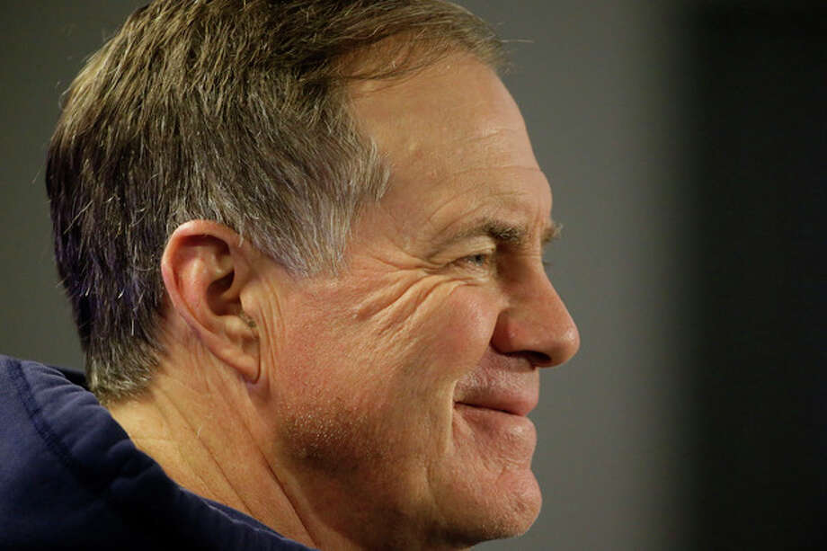 New England Patriots head coach Bill Belichick smiles as he listens to a reporter ask what his favorite Christmas song is during a media availability at the NFL football team's facility in Foxborough, Mass., Wednesday, Dec. 18, 2013. (AP Photo/Stephan Savoia) / AP
