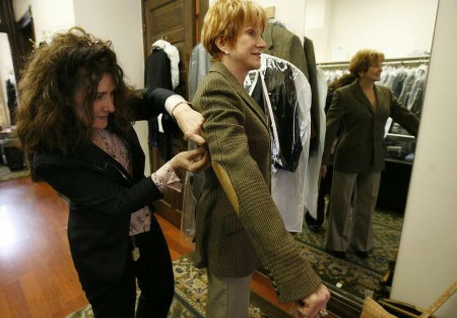 Left, Golden Needle Tailoring owner Maria Tesseris tailors the clothing of Nancy Couta, in Chicago, Illinois, Thursday, October 23, 2008. (Antonio Perez/Chicago Tribune/MCT)