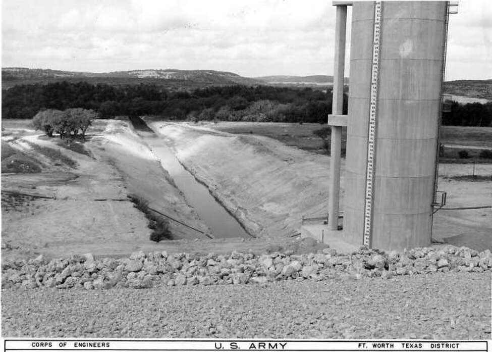 A view of the yet-to-be filled Canyon Lake in September 1962, taken from the control tower looking west.